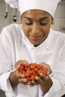 Chefs select vegetables for their kitchens.
