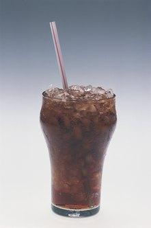 Carbonation in diet sodas may erode your tooth enamel.