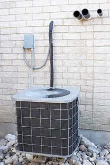 The outside condenser unit houses the contactor.