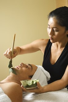 Cosmetologists provide services such as facials to clients.