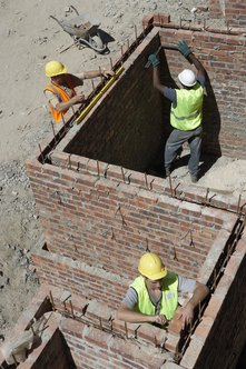 Construction masons build walls out of bricks, stones, or similar materials.