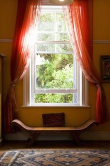 Window scarves can hang evenly or asymetrically.