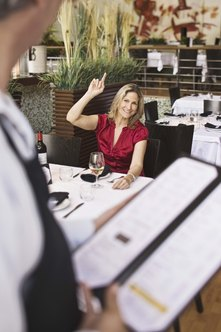 Patience with demanding customers is a key people skill for waiters.