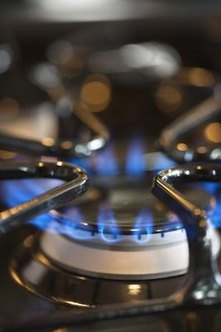 Put out a range's pilot light if you suspect a gas leak.