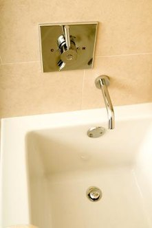 Unclogging a bathtub can require removing the drain assembly.
