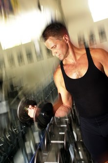 Alternative dumbbell curls enhance the shape of your upper arms.