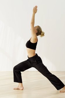 Ramp up calorie burn by bending deeper into warrior poses to strengthen the quadriceps and hamstring muscles.
