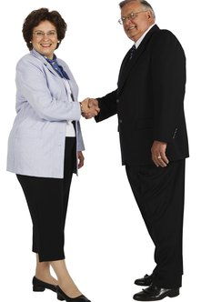 Professional handshakes are gender neutral in the early 21st century.