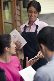Waitress jobs require organization and interpersonal skills.
