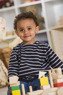 Arranging some low storage in your toddler's room can help teach him to pick up after himself.