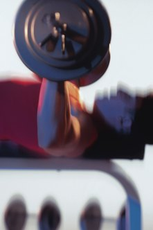 You can press more weight with a barbell than with dumbbells.