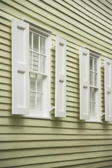 Snap vinyl siding panels together with a siding removal tool.