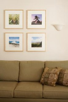 Living room picture groupings enhance your decor while telling visitors about your interests and taste..