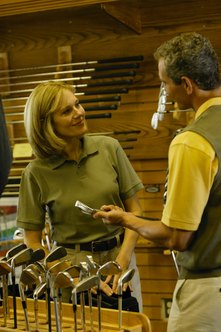 Pro shop staff help customers pick the right equipment.