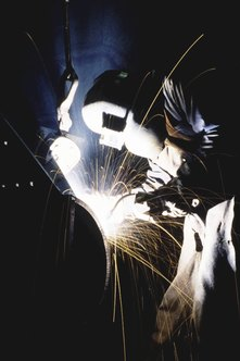 Special masks and glasses help welders avoid injury.