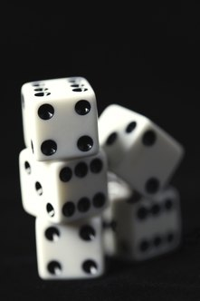 Rolling dice and flipping coins are simple examples of diverging probability-based sets of outcomes.