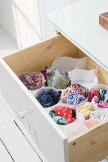 Plastic containers or bottles work well to divide drawers.