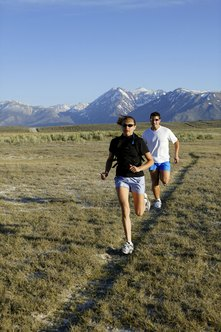 Pacing in cross country is affected by terrain and course constrictions.