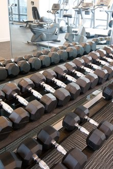 Use different weights of dumbbells in your program.