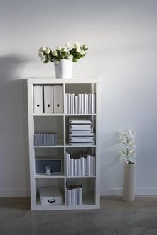 A freestanding bookshelf can section off a large room.
