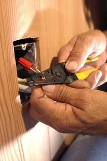 Replacing old electrical wiring is challenging but adds significant value.