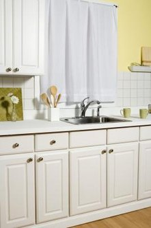 There are many simple ways to make the area above a kitchen sink more attractive.