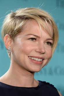 Actress Michelle Williams wears diamond earrings from Tiffany & Co. at its 2013 Blue Book Ball at Rockefeller Center in NYC.