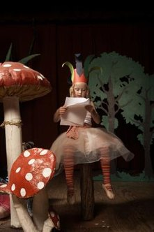 Enchanted garden toadstools set the scene for children's outdoor games of make-believe.