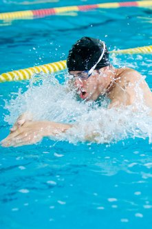 Improve your times by keeping your fingers together in the breaststroke.