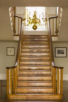 Oil stain is recommended on hardwood stairs.