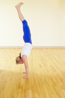 Strong upper body muscles can help you to hold a handstand.
