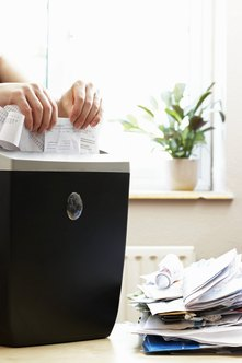 Always unplug the shredder before removing clogged paper.