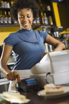 A food counter attendant may operate the cash register.