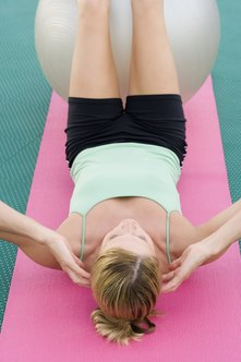Challenge yourself by placing a stability ball under your legs.