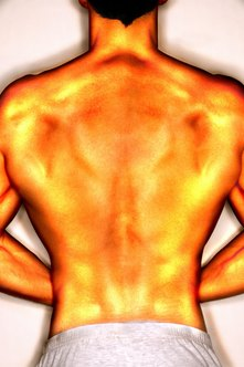 Muscle definition in the upper back results from working your lats correctly.