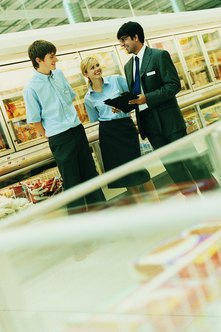 Retail operations managers often meet with employees to ensure quality control.