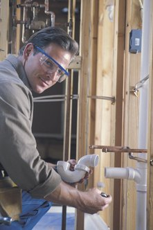 Plumbing instructors teach their students the use and installation of metal and PVC piping.
