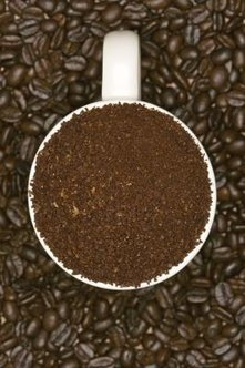 Coffee grounds add a nutrient boost to plant soil and compost piles.