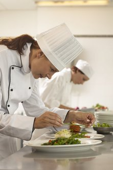 A restaurant kitchen utilizes many staff with varying skill levels.