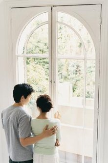 Leave the arch exposed for natural light when the bottom curtain is closed for privacy.