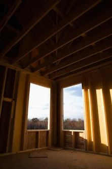 Joists support the walls and roof, but drywall conceals them.