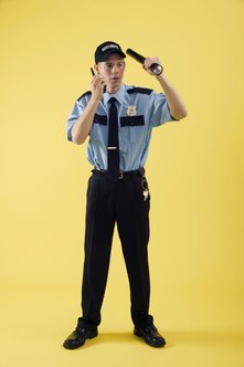 Private security guards are distinguishable through their uniforms.