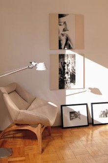 An artfully arranged group of pictures can turn an ordinary wall into an art gallery.