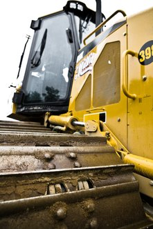 You can get heavy equipment at a fraction of the normal cost at a repo sale.