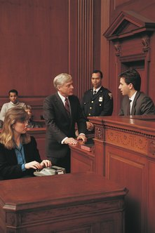 Court reporters use a steno machine to record legal proceedings.