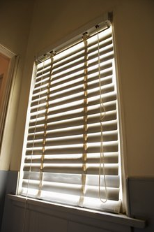 Vertical blinds require blackout fabric to prevent light coming through.