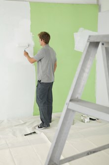Painting contractors work on diverse residential and commercial projects.