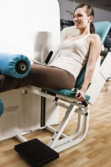 Take a seat for back support during a leg curl.