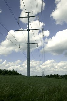 Sold energy goes to homes and businesses through transmission towers.