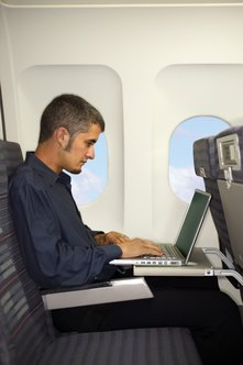 Connect to the Internet inflight using the plane's wireless access point.